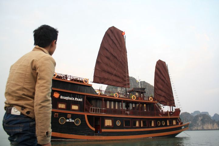 Picture of a man standing in front of the Dragon's Pearl boat